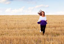 Free A Woman Is Running Through The Field Stock Photography - 16837202