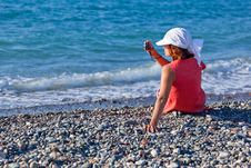 A Woman With A Camera On The Coast Stock Photo