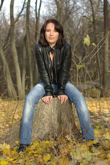 Female On A Stump Royalty Free Stock Photography