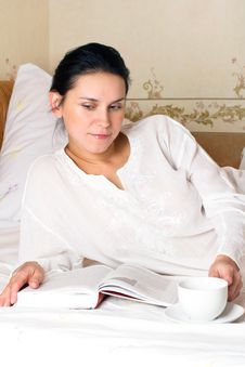 Free Portrait Of Young Woman On A Bed Stock Photography - 16839812