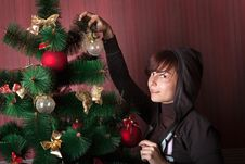 Free Girl Decorates The Christmas Tree Stock Photos - 16840103