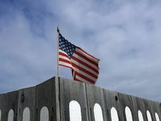 Free US Flag Behind Fence Stock Photography - 16842112