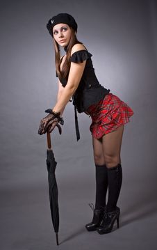 Gothic Girl In Mini Skirt With Umbrella Stock Photos