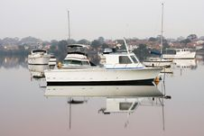 Free Boats Moored On Calm Glassy Water. Royalty Free Stock Images - 16847979