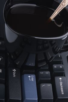 Free Cup On Computer Keyboard Stock Photography - 16848122