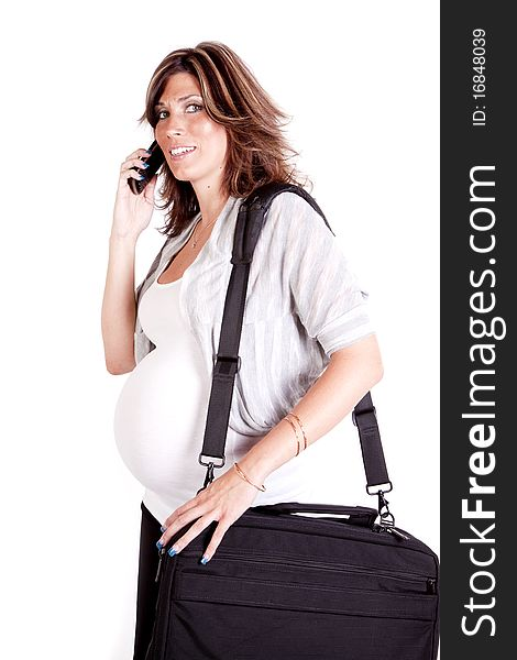 Pregnant woman on phone carrying a briefcase