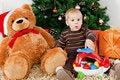 Free Baby Boy Discerning Santa Klaus At Christmas Stock Photo - 16854900