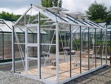 Free Formal Garden Glass Pavilion With Furniture Stock Image - 16850161