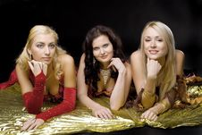 Free Three Young Woman  On Gold Wing Royalty Free Stock Photo - 16850525