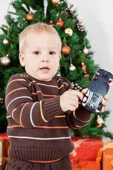 Free Baby Boy Playing With A Toy At Christmas Royalty Free Stock Image - 16854726