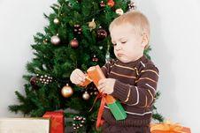 Free Baby Boy Opening The Christmas-box Stock Photos - 16854743