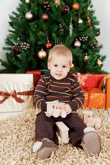 Free Baby Boy Playing With A Toy At Christmas Royalty Free Stock Images - 16854789