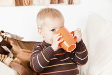 Free Baby Boy Drinking From A Big Jar Stock Photo - 16855010