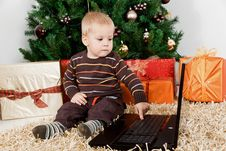 Free Baby Boy Playing With A Laptop At Christmas Stock Images - 16855034
