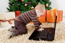 Free Baby Boy Playing With A Laptop At Christmas Royalty Free Stock Photos - 16855058