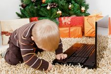 Free Baby Boy Playing With A Laptop At Christmas Royalty Free Stock Photo - 16855065