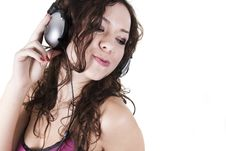 Free The Young Woman Listens To Music In Ear-phones Stock Image - 16855091