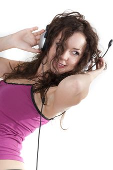 Free The Young Woman Listens To Music In Ear-phones Royalty Free Stock Photography - 16855167