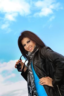 Free Young Smiling  Girl And Blue Sky Royalty Free Stock Photography - 16856867