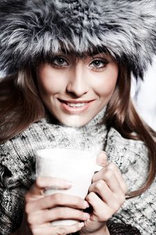 Free Girl Blowing On Hot Drink Stock Image - 16857961