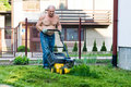 Free Man Cutting Grass With The Mower Royalty Free Stock Images - 16861089