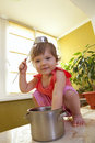 Free Little Girl With A Pan And Ladle On Her Head Stock Photography - 16869802