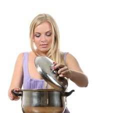 Free Blond Open A Lid Of Pan Stock Photography - 16861092