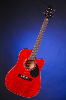 Acoustic Guitar Isolated On Blue Royalty Free Stock Photos