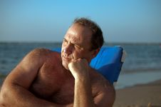 Free Man In Chair On The Beach . Stock Images - 16862104