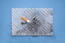 Cigarette End On Cigarette Stubbing Plate Stock Photos