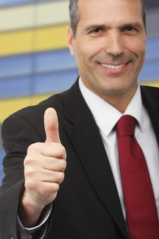 Free Businessman Showing Thumbs-up Sign Stock Image - 16866251