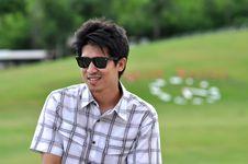 Free Asia Thailand Man Sit Smile  Sunglasses Stock Images - 16867334