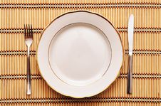 Knife, White Plate And Fork Royalty Free Stock Photography