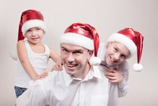 Free Happy Children And Man In Santa Hat Royalty Free Stock Image - 16869256