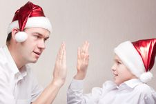 Free Happy Teen And Man In Santa Hat Royalty Free Stock Photography - 16869307