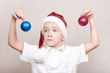 Free Boy In Red Christmas Hat Royalty Free Stock Images - 16869429