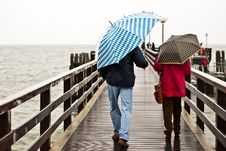 Free With Umbrella On The Pier Royalty Free Stock Image - 16869736