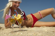 Christmas Women With Martini On The Beachfront Stock Image