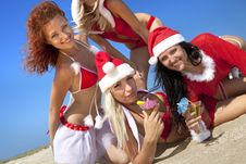 Free Women In Christmas Suit With Martini On The Beach Royalty Free Stock Photo - 16869825
