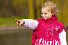 Free Little Girl Pointing On Something. Stock Images - 16870134
