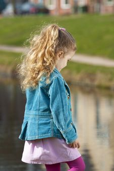 Free Little Girl Ashore River. Stock Photo - 16870300
