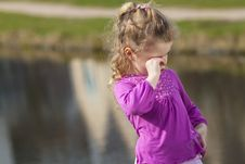 Crying Girl Ashore River. Royalty Free Stock Photography