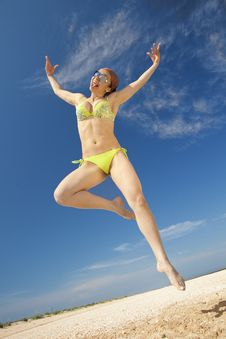 Free Girl Jumping On A Beach Stock Photo - 16871440