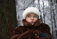 Free The Surprised Girl In A Fur Coat Royalty Free Stock Photos - 16872388