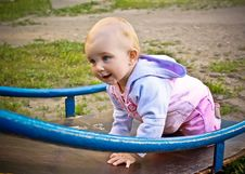 Free Beautiful Baby Girl Climbing A Slide In Playground Royalty Free Stock Photography - 16875937