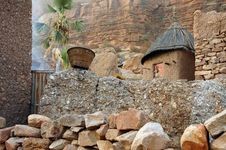 Free A Traditional Dogon Granary Below Cliff Face Stock Images - 16876544