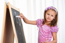 Little Girl Wrote In Chalk Royalty Free Stock Images