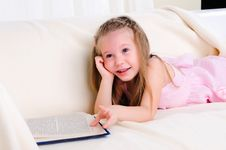 Little Girl Lying On The Couch Stock Photos
