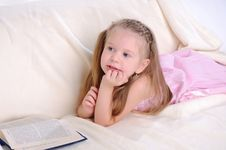 Little Girl Lying On The Couch Stock Images