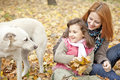 Free Two Sisters Sitting In The Park Stock Image - 16883361